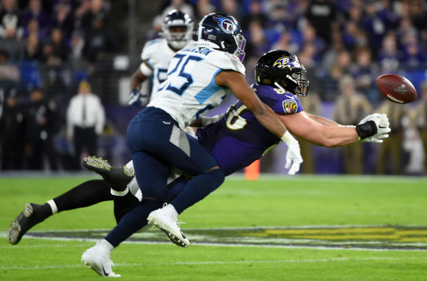BALTIMORE, MARYLAND - JANUARY 11: Nick Boyle #86 of the Baltimore Ravens is unable to make the catch over Adoree' Jackson #25 of the Tennessee Titans during the AFC Divisional Playoff game at M&T Bank Stadium on January 11, 2020 in Baltimore, Maryland. (Photo by Will Newton/Getty Images)