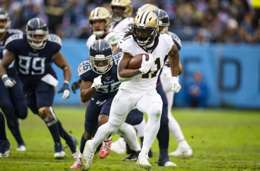 NASHVILLE, TN - DECEMBER 22: Alvin Kamara #41 of the New Orleans Saints carries the ball for a touchdown during the third quarter against the Tennessee Titans at Nissan Stadium on December 22, 2019 in Nashville, Tennessee. New Orleans defeats Tennessee 38-28. (Photo by Brett Carlsen/Getty Images)