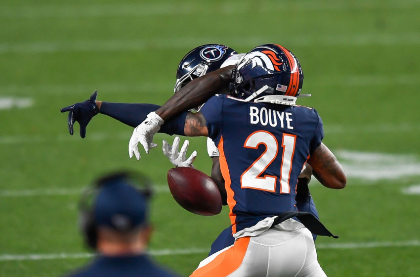 DENVER, CO - SEPTEMBER 14: A.J. Bouye #21 of the Denver Broncos breaks up a pass intended for A.J. Brown #11 of the Tennessee Titans in the first quarter of a game at Empower Field at Mile High on September 14, 2020 in Denver, Colorado. (Photo by Dustin Bradford/Getty Images)