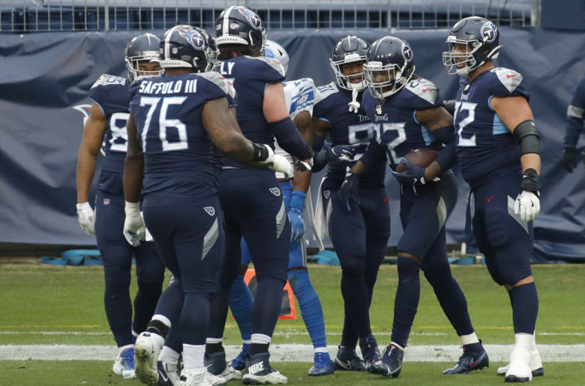 NASHVILLE, TENNESSEE - DECEMBER 20: Running back Derrick Henry #22 of the Tennessee Titans celebrates with teammates after rushing for a touchdown in the first quarter of the game against the Detroit Lions at Nissan Stadium on December 20, 2020 in Nashville, Tennessee. (Photo by Frederick Breedon/Getty Images)
