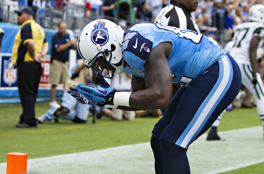 NASHVILLE, TN - SEPTEMBER 29: Delanie Walker #82 of the Tennessee Titans bows to the fans after scoring a touchdown against the New York Jets at LP Field on September 29, 2013 in Nashville, Tennessee. The Titans defeated the Jets 38-13. (Photo by Wesley Hitt/Getty Images)