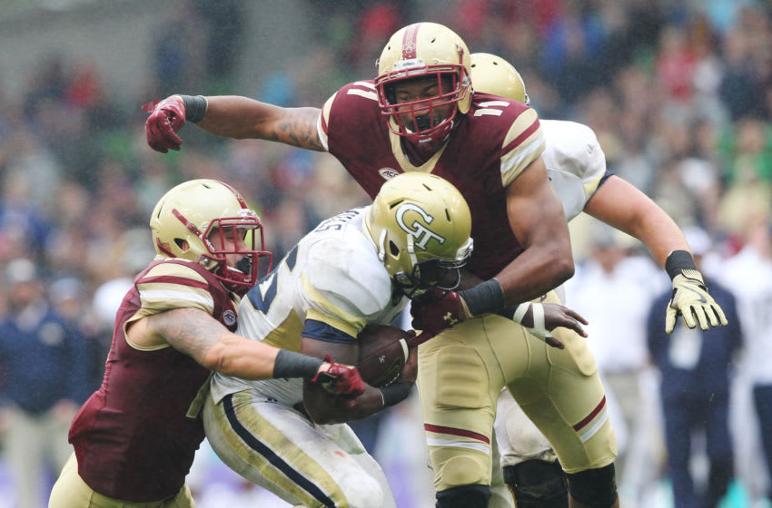 DUBLIN, IRELAND - SEPTEMBER 03: Dedrick Mills of Georgia Tech is tackled by Ty Schwab and Wyatt Ray of Boston College during the Aer Lingus College Football Classic Ireland 2016 at Aviva Stadium on September 3, 2016 in Dublin, Ireland. (Photo by Patrick Bolger/Getty Images)