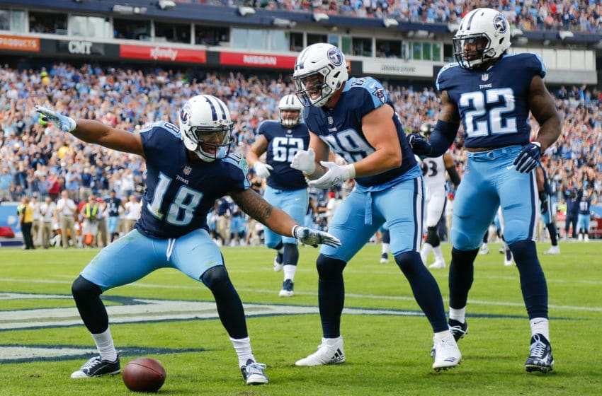 NASHVILLE, TN - NOVEMBER 05: Rishard Matthews #18 of the Tennessee Titans celebrates with teammates after a touchdown during the first half against the Baltimore Ravens at Nissan Stadium on November 5, 2017 in Nashville, Tennessee. (Photo by Michael Reaves/Getty Images)