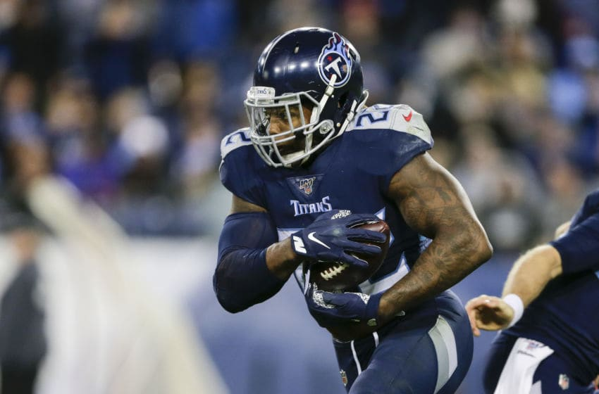 NASHVILLE, TENNESSEE - NOVEMBER 24: Derrick Henry #22 of the Tennessee Titans runs with the ball during the third quarter of the game to score a touchdown against the Jacksonville Jaguars at Nissan Stadium on November 24, 2019 in Nashville, Tennessee. (Photo by Silas Walker/Getty Images)