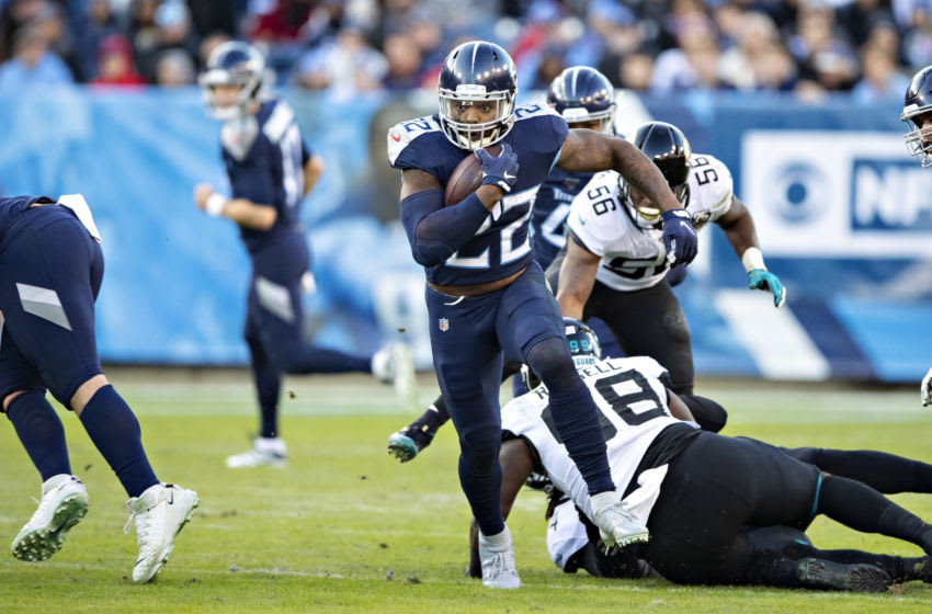 NASHVILLE, TN - NOVEMBER 24: Derrick Henry #22 of the Tennessee Titans runs the ball during the first half of a game against the Jacksonville Jaguars at Nissan Stadium on November 24, 2019 in Nashville, Tennessee. The Titans defeated the Jaguars 42-20. (Photo by Wesley Hitt/Getty Images)