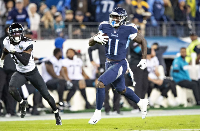 NASHVILLE, TN - NOVEMBER 24: A.J. Brown #11 of the Tennessee Titans runs for a touchdown during the second half of a game against the Jacksonville Jaguars at Nissan Stadium on November 24, 2019 in Nashville, Tennessee. The Titans defeated the Jaguars 42-20. (Photo by Wesley Hitt/Getty Images)
