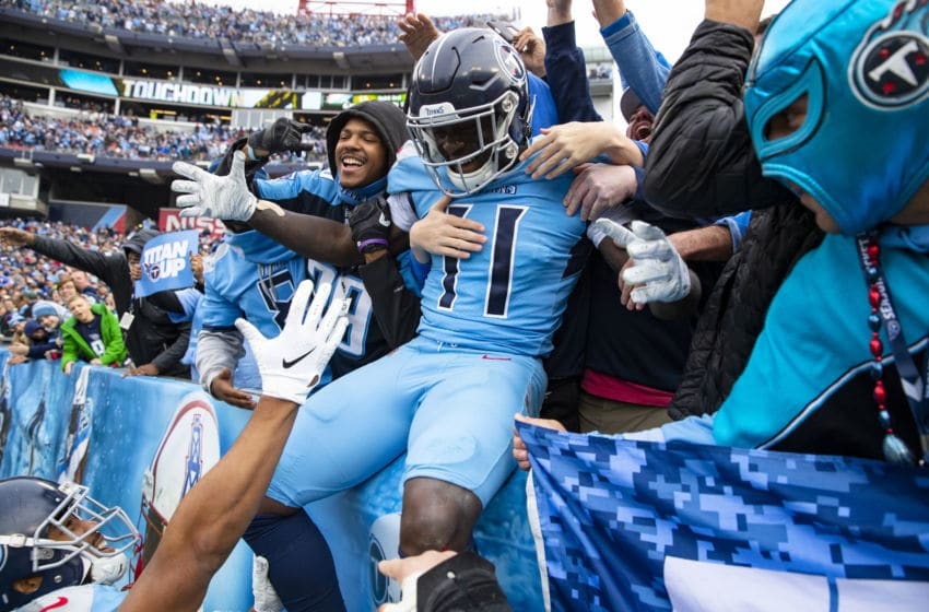 NASHVILLE, TN - DECEMBER 15: A.J. Brown #11 of the Tennessee Titans celebrates a touchdown reception by jumping into the crowd during the fourth quarter against the Houston Texans at Nissan Stadium on December 15, 2019 in Nashville, Tennessee. Houston defeats Tennessee 24-21. (Photo by Brett Carlsen/Getty Images)