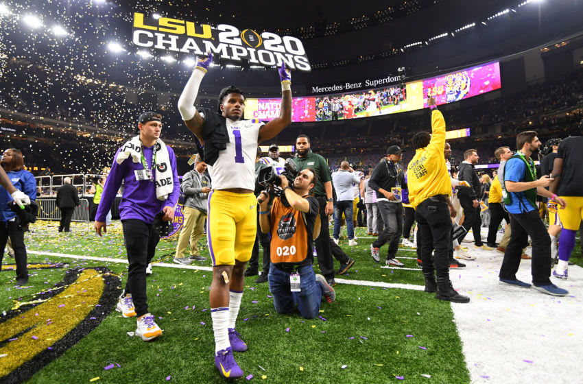 NEW ORLEANS, LA - JANUARY 13: Kristian Fulton #1 of the LSU Tigers celebrates after defeating the Clemson Tigers during the College Football Playoff National Championship held at the Mercedes-Benz Superdome on January 13, 2020 in New Orleans, Louisiana. (Photo by Jamie Schwaberow/Getty Images)