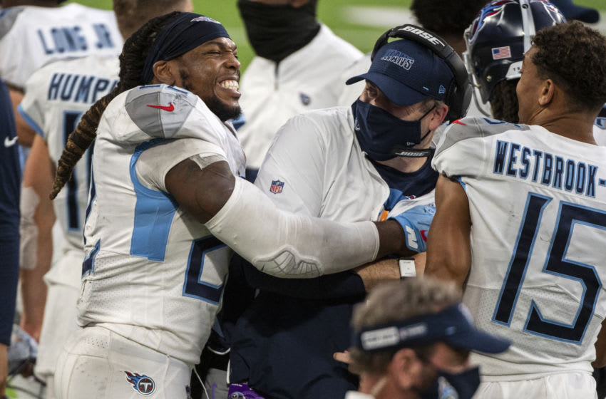 MINNEAPOLIS, MN - SEPTEMBER 27: Derrick Henry #22 of the Tennessee Titans celebrates with offensive coordinator Arthur Smith at the end of the game agains the Minnesota Vikings at U.S. Bank Stadium on September 27, 2020 in Minneapolis, Minnesota. The Titans defeated the Vikings 31-30. (Photo by Stephen Maturen/Getty Images)