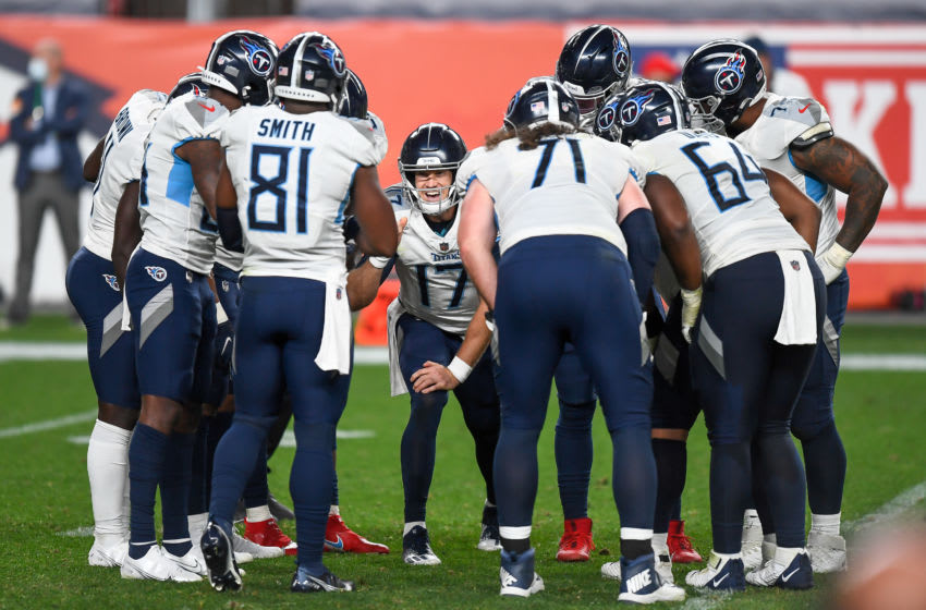DENVER, CO - SEPTEMBER 14: Ryan Tannehill #17 of the Tennessee Titans huddles with teammates in the fourth quarter of a game against the Denver Broncos at Empower Field at Mile High on September 14, 2020 in Denver, Colorado. (Photo by Dustin Bradford/Getty Images)