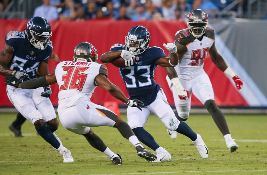 NASHVILLE, TN - AUGUST 18: Running back Dion Lewis #33 of the Tennessee Titans rushes against M.J. Stewart #36 of the Tampa Bay Buccaneers during the first half of a pre-season game at Nissan Stadium on August 18, 2018 in Nashville, Tennessee. (Photo by Frederick Breedon/Getty Images)