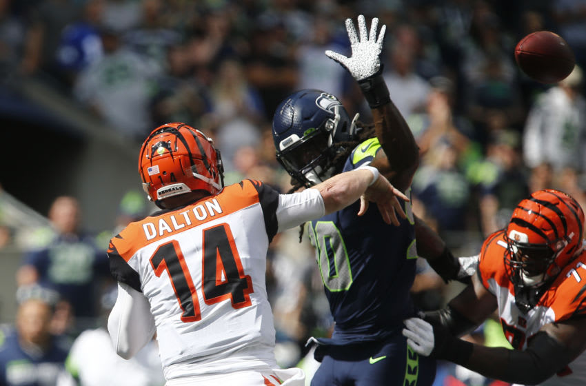 SEATTLE, WA - SEPTEMBER 08: Jadeveon Clowney #90 of the Seattle Seahawks pressures Andy Dalton #14 of the Cincinnati Bengals in the first quarter at CenturyLink Field on September 8, 2019 in Seattle, Washington. (Photo by Lindsey Wasson/Getty Images)