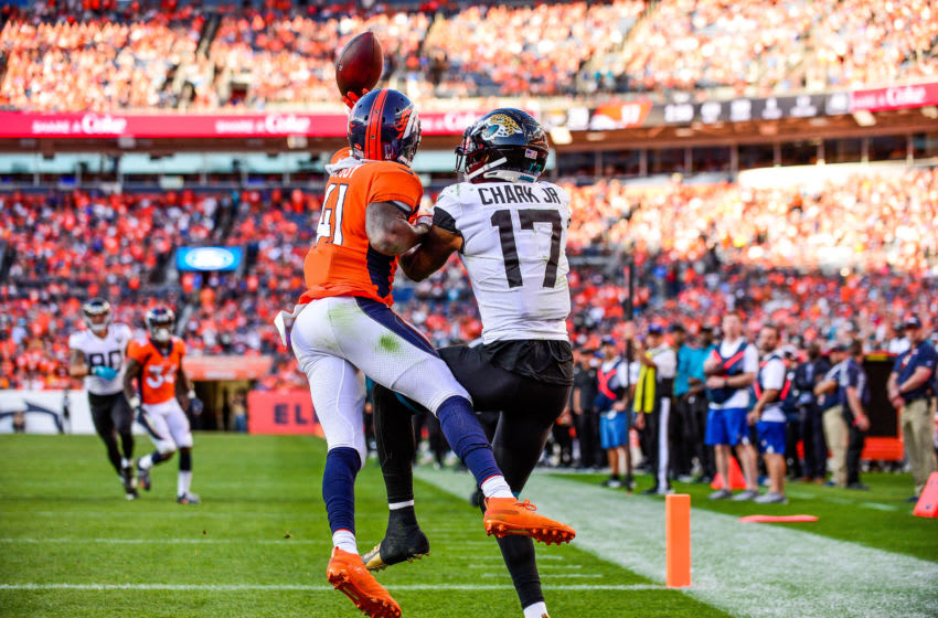 DENVER, CO - SEPTEMBER 29: DeVante Bausby #41 of the Denver Broncos defends a red zone pass intended for D.J. Chark #17 of the Jacksonville Jaguars in the fourth quarter of a game at Empower Field at Mile High on September 29, 2019 in Denver, Colorado. (Photo by Dustin Bradford/Getty Images)