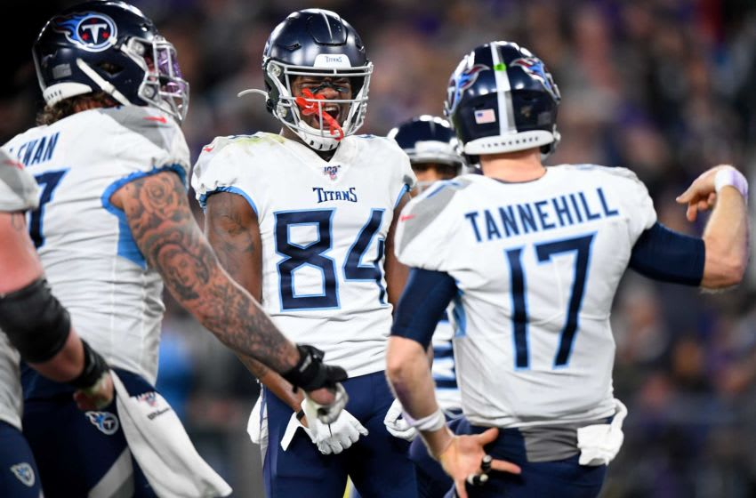 Tennessee Titans wide receiver Corey Davis (84) reacts after quarterback Ryan Tannehill (17) scored a touchdown against the Baltimore Ravens during the third quarter at M&T Bank Stadium in Baltimore, Md., Saturday, Jan. 11, 2020. Titansravens An 011220 009