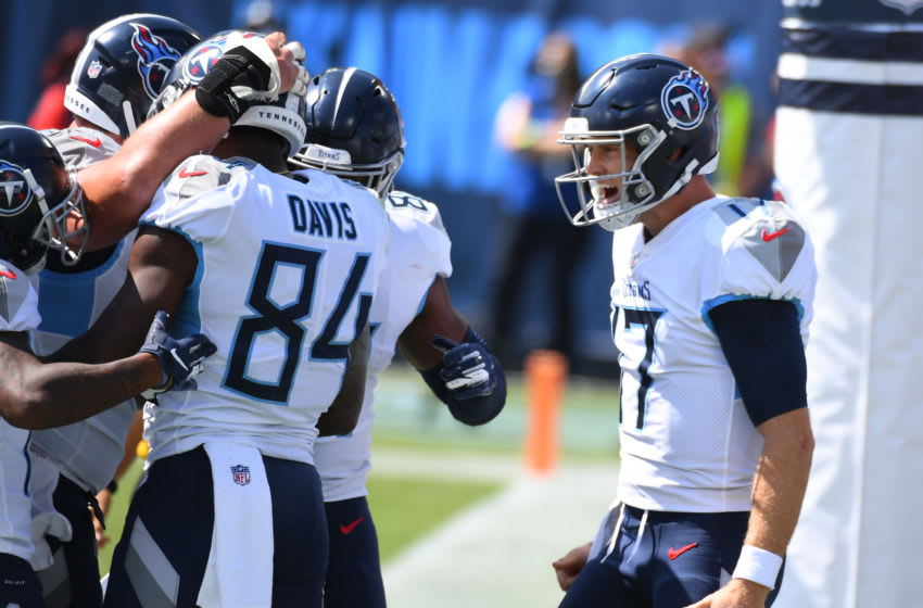 Sep 20, 2020; Nashville, Tennessee, USA; Tennessee Titans quarterback Ryan Tannehill (17) celebrates after throwing a touchdown to Tennessee Titans wide receiver Corey Davis (84) during the first half against the Jacksonville Jaguars at Nissan Stadium. Mandatory Credit: Christopher Hanewinckel-USA TODAY Sports