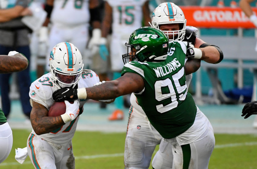 Oct 18, 2020; Miami Gardens, Florida, USA; New York Jets defensive tackle Quinnen Williams (95) reaches for Miami Dolphins running back Myles Gaskin (37) during the second half at Hard Rock Stadium. Mandatory Credit: Jasen Vinlove-USA TODAY Sports