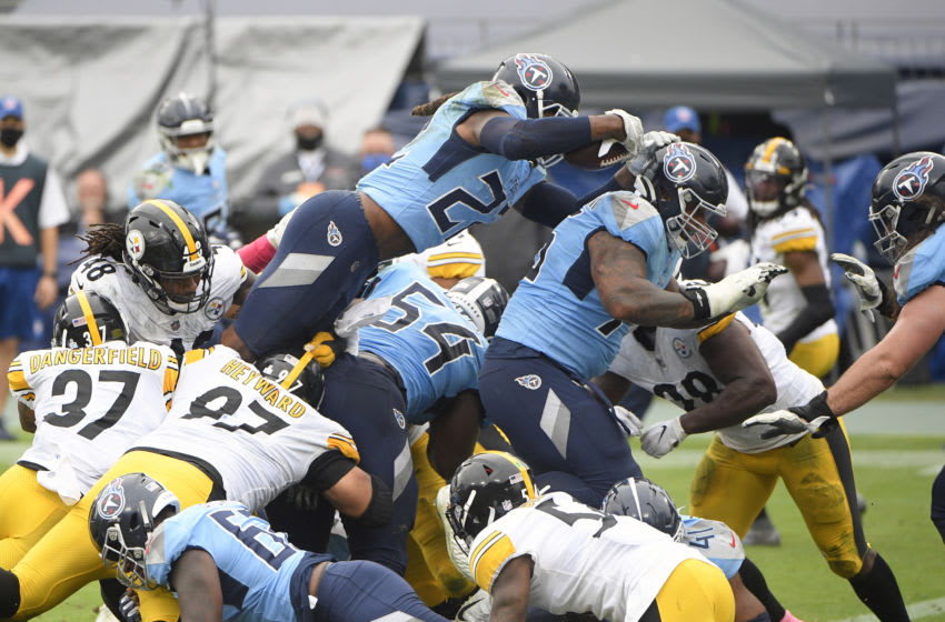 Oct 25, 2020; Nashville, Tennessee, USA; Tennessee Titans running back Derrick Henry (22) dives for the touchdown against the Pittsburgh Steelers during the second half at Nissan Stadium. Mandatory Credit: Steve Roberts-USA TODAY Sports