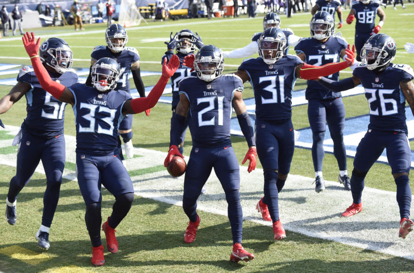 Jan 10, 2021; Nashville, Tennessee, USA;Tennessee Titans cornerback Malcolm Butler (21) and the team celebrate his interception in the first quarter during the Tennessee Titans game against the Baltimore Ravens. Mandatory Credit: George Walker IV/The Tennessean via USA TODAY Sports