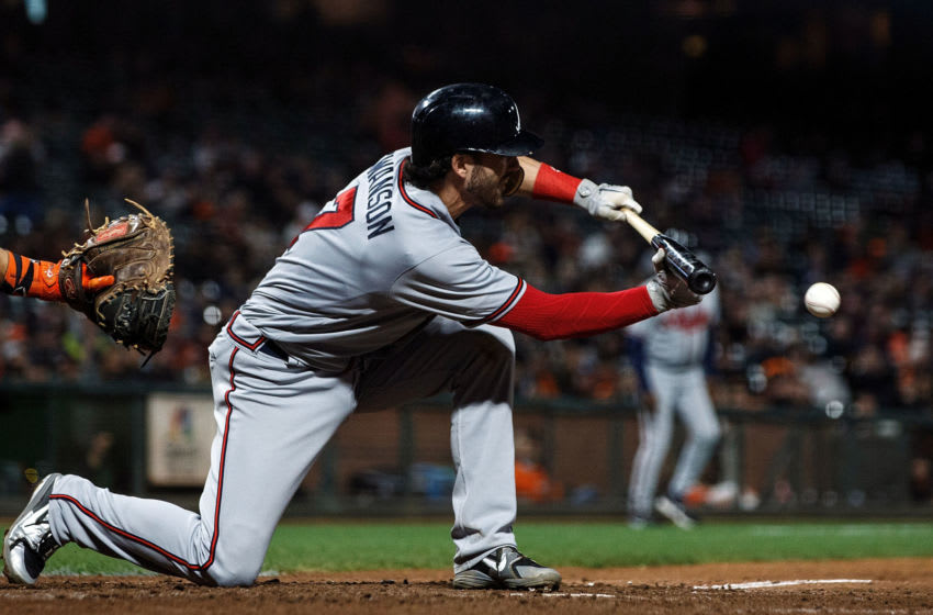 Dansby Swanson of the Atlanta Braves hits a 9th inning RBI sacrifice bunt against the Giants in 2018. (Photo by Jason O. Watson/Getty Images)