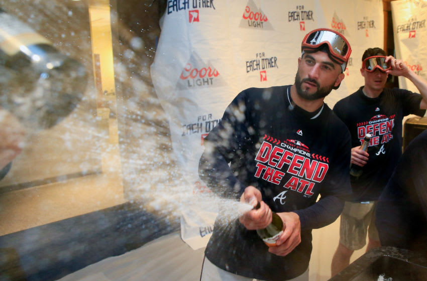 ATLANTA, GA - SEPTEMBER 22: Nick Markakis #22 of the Atlanta Braves celebrates with champagne after clinching the NL East Division against the Philadelphia Phillies at SunTrust Park on September 22, 2018 in Atlanta, Georgia. (Photo by Daniel Shirey/Getty Images)