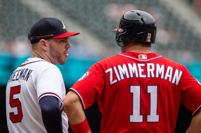 ATLANTA, GA - SEPTEMBER 16: Freddie Freeman #5 of the Atlanta Braves chats with Ryan Zimmerman of the Washington Nationals at first base at SunTrust Park on September 16, 2018 in Atlanta, Georgia.(Photo by Kelly Kline/Getty Images)