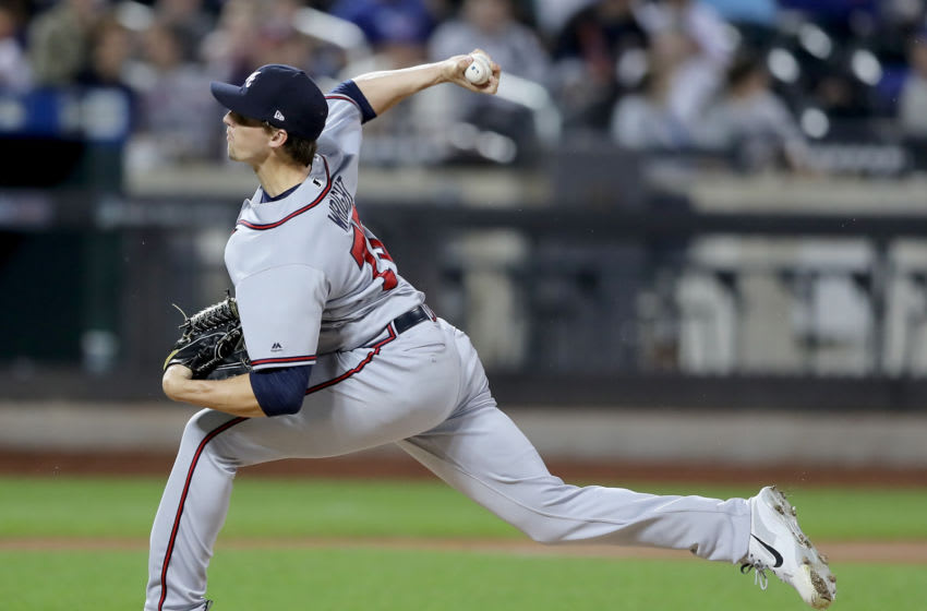NEW YORK, NY - SEPTEMBER 26: Kyle Wright #73 of the Atlanta Braves delivers a pitch to Michael Conforto #30 of the New York Mets in the eight inning on September 26,2018 at Citi Field in the Flushing neighborhood of the Queens borough of New York City. (Photo by Elsa/Getty Images)