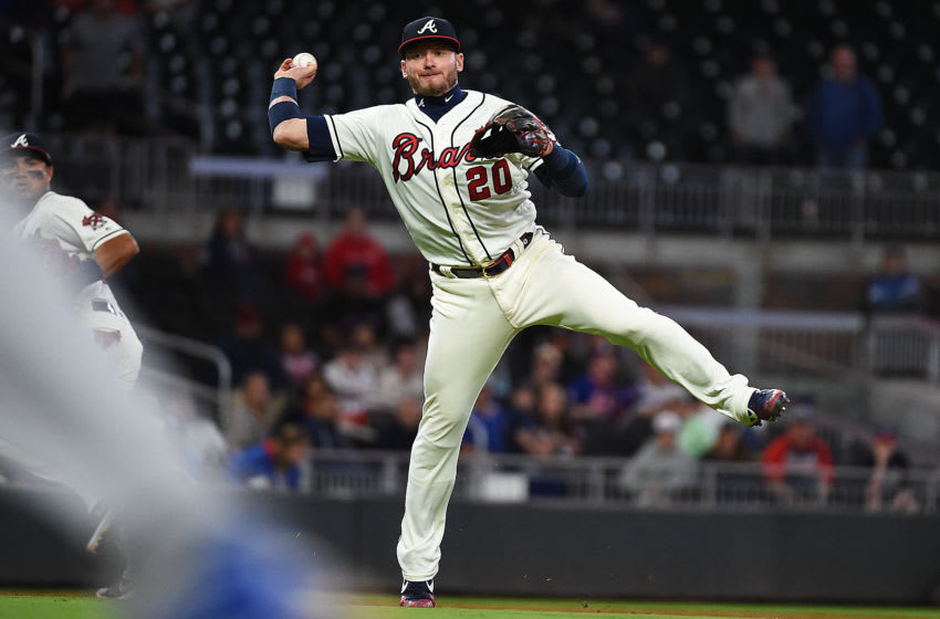 ATLANTA, GEORGIA - APRIL 14: Josh Donaldson #20 of the Atlanta Braves fields a ball against the New York Mets during the game at SunTrust Park on April 14, 2019 in Atlanta, Georgia. (Photo by Logan Riely/Getty Images)