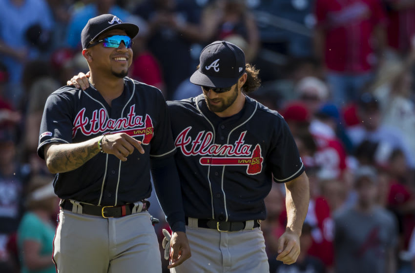 WASHINGTON, DC - JUNE 23: Johan Camargo #17 of the Atlanta Braves and Charlie Culberson #8 celebrate after the game against the Washington Nationals at Nationals Park on June 23, 2019 in Washington, DC. (Photo by Scott Taetsch/Getty Images)