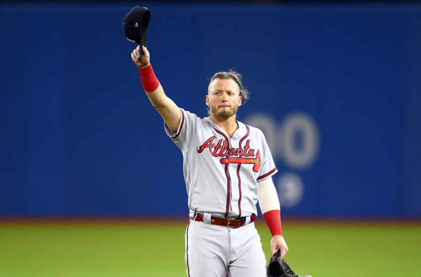 TORONTO, ON - AUGUST 27: Josh Donaldson #20 of the Atlanta Braves acknowledges applause from the crowd after a video tribute on the big screen prior to the first inning of an MLB game against the Toronto Blue Jays at Rogers Centre on August 27, 2019 in Toronto, Canada. (Photo by Vaughn Ridley/Getty Images)