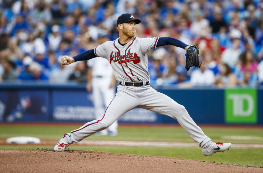 TORONTO, ONTARIO - AUGUST 28: Mike Foltynewicz #26 of the Atlanta Braves pitches against the Toronto Blue Jays in the first inning during their MLB game at the Rogers Centre on August 28, 2019 in Toronto, Canada. (Photo by Mark Blinch/Getty Images)