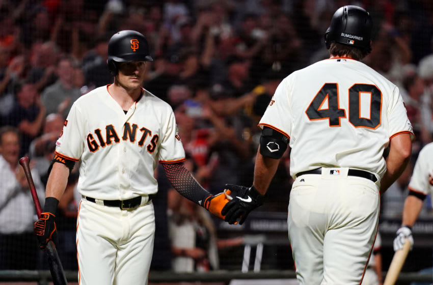 SAN FRANCISCO, CALIFORNIA - SEPTEMBER 24: Madison Bumgarner #40 celebrates a solo home run with Mike Yastrzemski #5 of the San Francisco Giants during the third inning against the Colorado Rockies at Oracle Park on September 24, 2019 in San Francisco, California. (Photo by Daniel Shirey/Getty Images)
