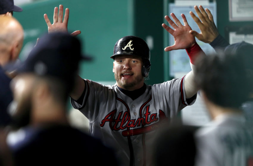 KANSAS CITY, MISSOURI - SEPTEMBER 25: Josh Donaldson #20 of the Atlanta Braves is congratulated by teammates in the dugout after scoring during the 8th inning of the game against the Kansas City Royals at Kauffman Stadium on September 25, 2019 in Kansas City, Missouri. (Photo by Jamie Squire/Getty Images)
