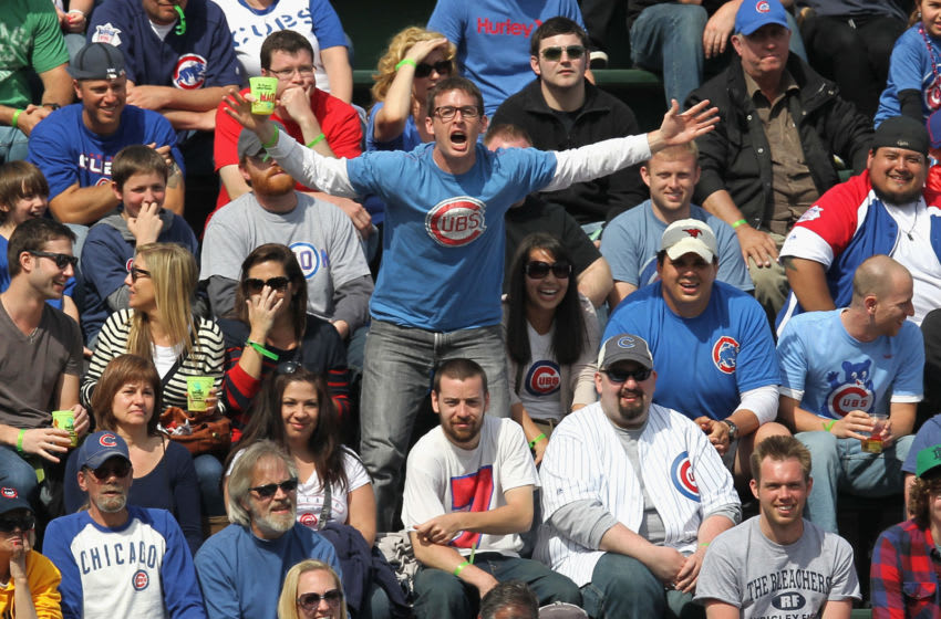 CHICAGO, IL - APRIL 07: Fans of the Chicago Cubs in the left field bleachers harass Roger Bernadina of the Washington Nationals at Wrigley Field on April 7, 2012 in Chicago, Illinois. The Nationals defeated the Cubs 7-4. (Photo by Jonathan Daniel/Getty Images)