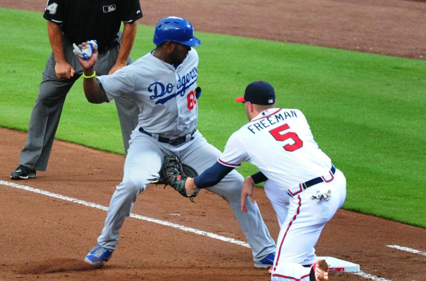 Atlanta Braves 1st baseman Freddie Freeman picks off his future teammate, Yasiel Puig. (Photo by Scott Cunningham/Getty Images)