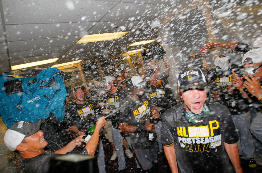 ATLANTA, GA - SEPTEMBER 23: The Pittsburgh Pirates celebrate clinching a National League playoff spot after their 3-2 win over the Atlanta Braves at Turner Field on September 23, 2014 in Atlanta, Georgia. (Photo by Kevin C. Cox/Getty Images)