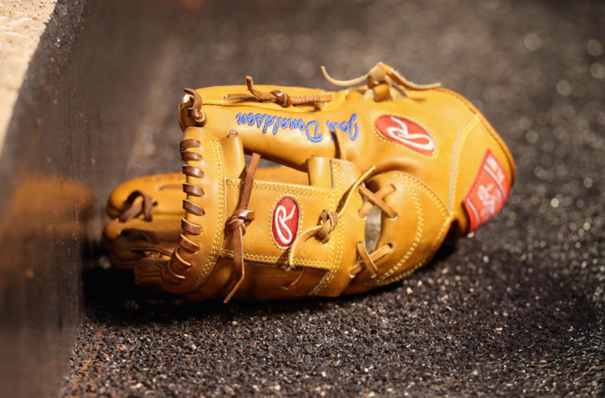 BALTIMORE, MD - APRIL 21: The glove of third baseman Josh Donaldson #20 of the Toronto Blue Jays sits in the dugout after in the first inning against the Baltimore Orioles at Oriole Park at Camden Yards on April 21, 2016 in Baltimore, Maryland. (Photo by Rob Carr/Getty Images)