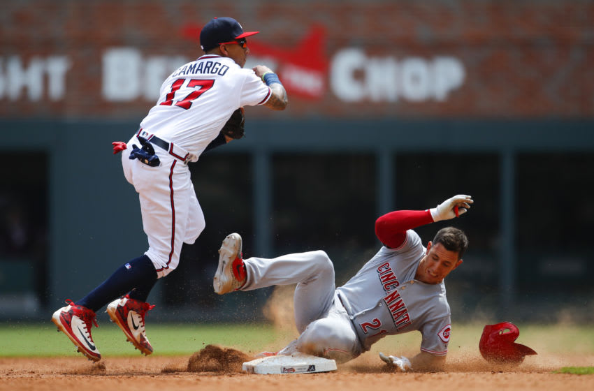 ATLANTA, GA - JUNE 27: Johan Camargo #17 of the Atlanta Braves turns a double play as Michael Lorenzen #21 of the Cincinnati Reds slides into second in the ninth inning of an MLB game at SunTrust Park on June 27, 2018 in Atlanta, Georgia. The Cincinnati Reds won the game 6-5. (Photo by Todd Kirkland/Getty Images)