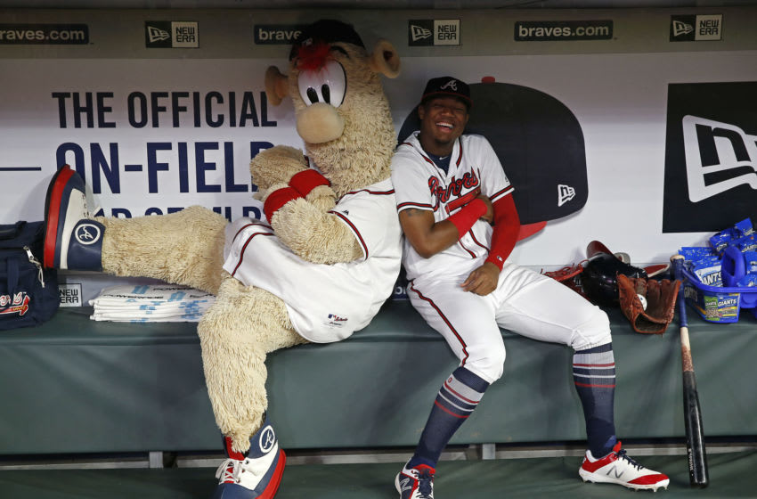 ATLANTA, GA - JULY 31: Atlanta Braves mascot Blooper and left fielder Ronald Acuna, Jr. #13 play around in the dugout during a rain delay before the game against the Miami Marlins at SunTrust Park on July 31, 2018 in Atlanta, Georgia. (Photo by Mike Zarrilli/Getty Images)