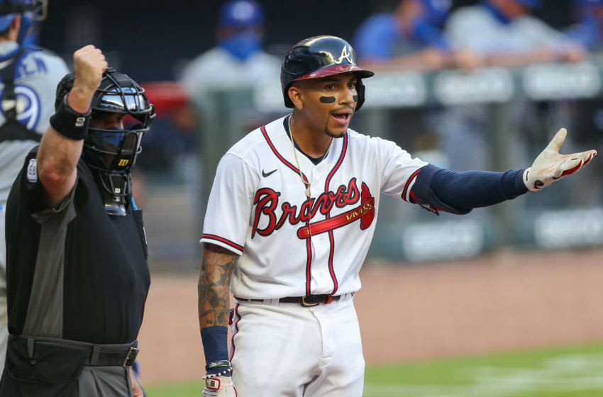 ATLANTA, GA - AUGUST 5: Johan Camargo #17 of the Atlanta Braves argues a strike out call from umpire Marty Foster #60 in the fifth inning of a game against the Toronto Blue Jays at Truist Park on August 5, 2020 in Atlanta, Georgia. (Photo by Carmen Mandato/Getty Images)