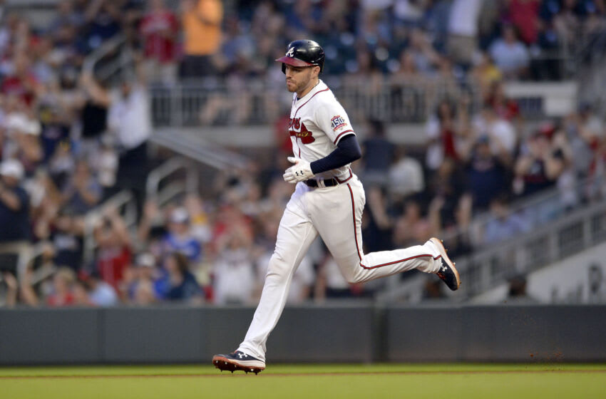 ATLANTA, GA - JULY 17: Freddie Freeman #5 of the Atlanta Braves rounds the bases after hitting a home run in the fifth inning against the Tampa Bay Rays at Truist Park on July 17, 2021 in Atlanta, Georgia. (Photo by Edward M. Pio Roda/Getty Images)