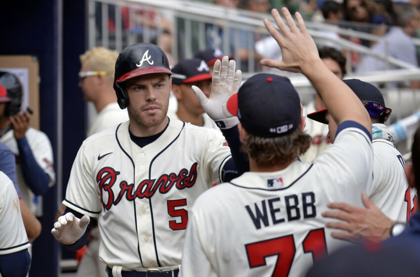 ATLANTA, GA - SEPTEMBER 12: Freddie Freeman #5 of the Atlanta Braves celebrates with Jacob Webb #71 after hitting a home run in the seventh inning against the Miami Marlins at Truist Park on September 12, 2021 in Atlanta, Georgia. (Photo by Edward M. Pio Roda/Getty Images)