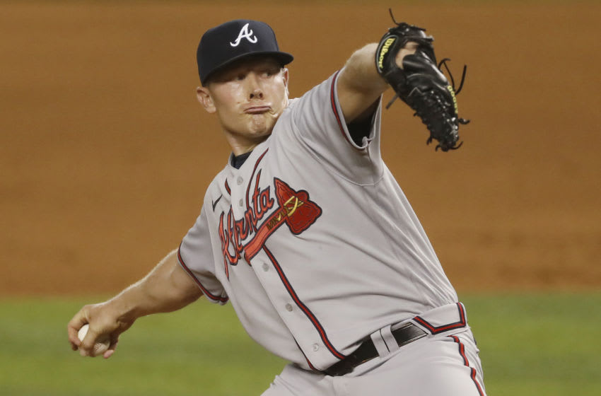 MIAMI, FLORIDA - AUGUST 14: Mark Melancon #36 of the Atlanta Braves delivers a pitch in the eighth inning against the Miami Marlins at Marlins Park on August 14, 2020 in Miami, Florida. (Photo by Michael Reaves/Getty Images)