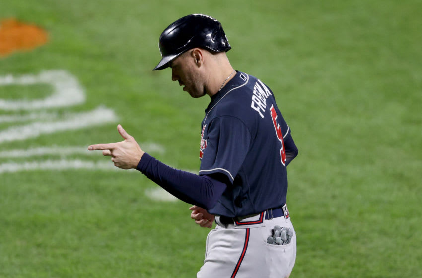 BALTIMORE, MARYLAND - SEPTEMBER 15: Freddie Freeman #5 of the Atlanta Braves celebrates after scoring in the ninth inning against the Baltimore Orioles at Oriole Park at Camden Yards on September 15, 2020 in Baltimore, Maryland. (Photo by Rob Carr/Getty Images)