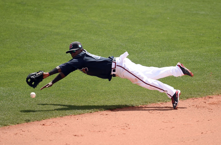 LAKE BUENA VISTA, FL - MARCH 16: Ozzie Albies #87 of the Atlanta Braves dives for a ground ball during the fifth inning of a spring training game against the St. Louis Cardinals at Champion Stadium on March 16, 2016 in Lake Buena Vista, Florida. (Photo by Stacy Revere/Getty Images)
