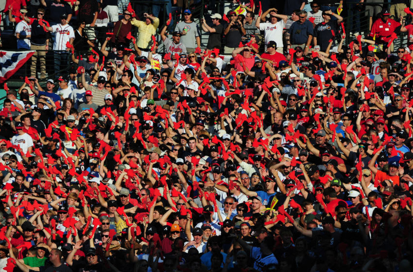 ATLANTA, GA - OCTOBER 5: A fan of the Atlanta Braves do the Tomahawk Chop during the game against the St. Louis Cardinals during the National League Wild Card Game at Turner Field on October 5, 2012 in Atlanta, Georgia. (Photo by Scott Cunningham/Getty Images)