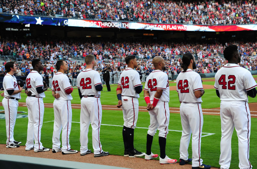 ATLANTA, GA - APRIL 15: Members of the Atlanta Braves stand during the national anthem wearing number 42 for the game against the San Diego Padres at SunTrust Park on April 15, 2017 in Atlanta, Georgia. All MLB players are wearing number 42 in honor of Jackie Robinson. (Photo by Scott Cunningham/Getty Images)