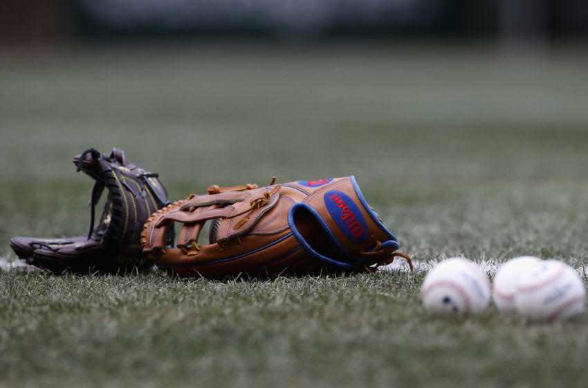 CHICAGO, IL - APRIL 13: Gloves and balls are seen on the field before the Chicago Cubs take on the Atlanta Braves at Wrigley Field on April 13, 2018 in Chicago, Illinois. The Braves defeated the Cubs 4-0. (Photo by Jonathan Daniel/Getty Images)