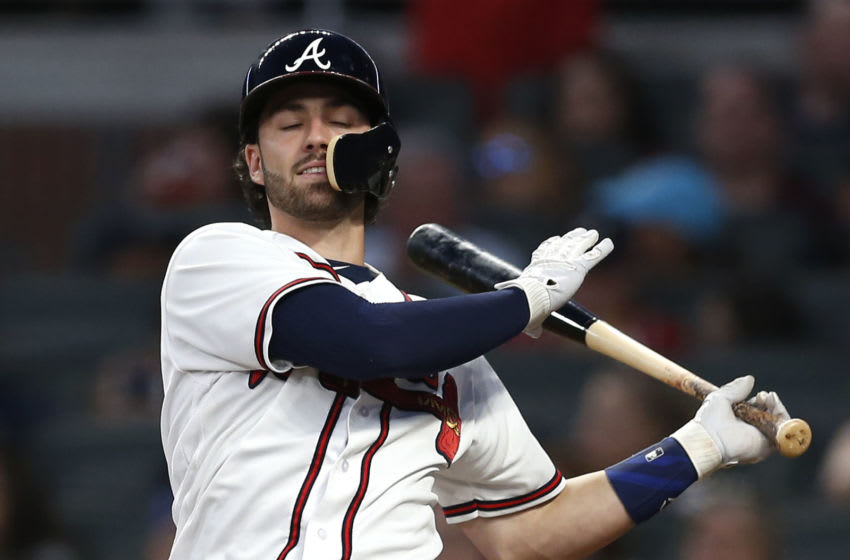 ATLANTA, GA - JULY 28: Shortstop Dansby Swanson #7 of the Atlanta Braves swings and misses during the game against the Los Angeles Dodgers at SunTrust Park on July 28, 2018 in Atlanta, Georgia. (Photo by Mike Zarrilli/Getty Images)