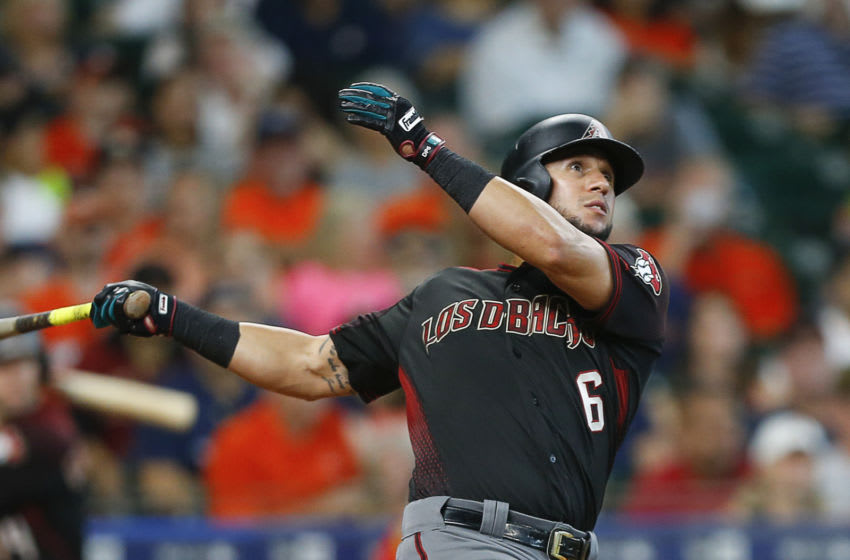 HOUSTON, TX - SEPTEMBER 16: David Peralta #6 of the Arizona Diamondbacks hits a home run in the sixth inning against the Houston Astros at Minute Maid Park on September 16, 2018 in Houston, Texas. (Photo by Bob Levey/Getty Images)