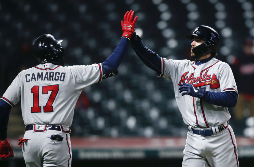CLEVELAND, OH - APRIL 20: Dansby Swanson #7 of the Atlanta Braves celebrates with Johan Camargo #17 after hitting a two run home run off Dan Otero #61 of the Cleveland Indians during the seventh inning of Game 2 of a doubleheader at Progressive Field on April 20, 2019 in Cleveland, Ohio. The Braves defeated the Indians 8-7. (Photo by Ron Schwane/Getty Images)